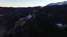 Aerial flight over fog forest with mountain range at sunset stock video footage