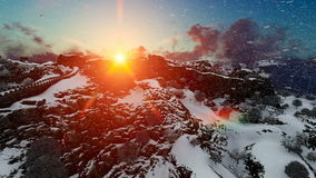 Aerial flight over Great wall of China at sunrise, snowing stock footage
