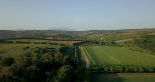Aerial flight over hills and polo fields at sunset. Aerial drone footage over hills and polo fields at sunset, camera moving right. Mavic Pro drone/quadcopter stock video footage