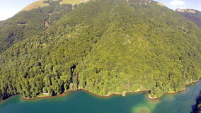 AERIAL: Flight over lake with forest around stock video footage