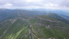 Aerial flight over mountain trails stock video footage
