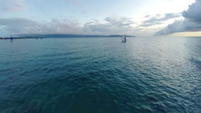 Aerial : Flight over the ocean and beautiful sailboat stock video