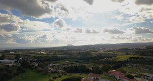 Aerial flight over small Spanish village. Aerial drone footage over small Spanish village with cloudy and overcast sky and smooth forward movement. Gibraltar stock footage