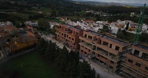 Aerial flight over small Spanish village. Aerial drone footage over small Spanish village with cloudy and overcast sky and smooth left dolly movement. White stock video