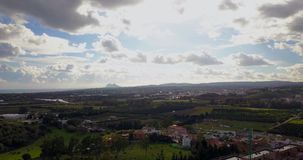 Aerial flight over small Spanish village. Aerial drone footage over small Spanish village with cloudy and overcast sky and smooth forward movement. Gibraltar stock video