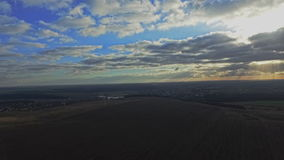 AERIAL: Flight over the wheat field in sunset stock footage