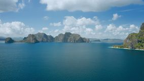 Aerial fly footage approaching Pinagbuyutan Island with Malpacao in Background. El Nido, Palawan, Philippines stock video