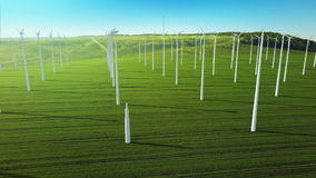 Aerial fly over grow up building wind turbines generating energy stock illustration