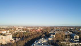 Aerial fly over spring Saint-Petersburg suburb Pushkin town view on streets in sunset Royalty Free Stock Photos