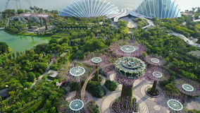 Aerial fly-over view of Gardens By The Bay, Singapore. Featuring Supertree Grove, Cloud Forest and Flower Dome