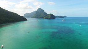 Aerial Fly-Over View of Tropical Beach Ocean with Boats, El-Nido, Palawan Island, Philippines 02