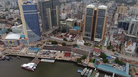 Aerial Flyby View of the Dar es Salaam Downtown skyline on a River Bay in cloudy weather