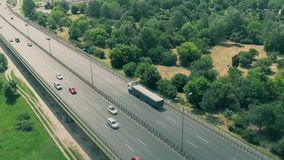 Aerial flyby view of highway traffic Stock Photos