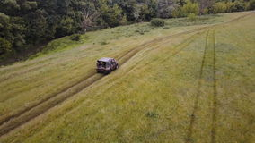 Aerial. Flying above the suv car driving fast offroad through rural countryside stock footage
