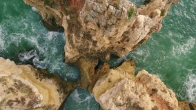Aerial. Flying along the shore of beach rocks Arrifes, Albufeira. Portugal stock footage
