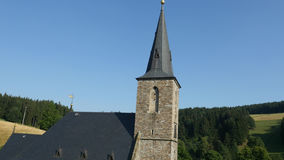 Aerial flying around historical church stock footage