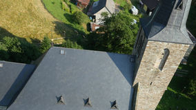 Aerial flying around historical church stock video footage