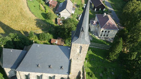 Aerial flying around historical church stock video