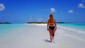 Aerial flying drone view of Maldives white sandy beach happy 1 person young beautiful young woman walking on. Sunny tropical paradise island with aqua blue sky stock photo