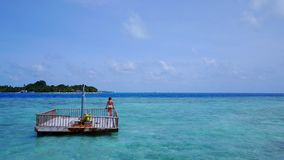 P02022 Aerial flying drone view of Maldives white sandy beach happy young woman relaxing on floating pontoon jetty Royalty Free Stock Photos