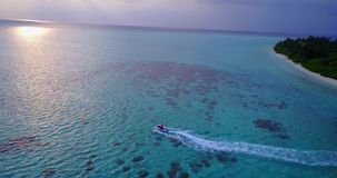 V06218 Aerial flying drone view of Maldives white sandy beach jetski riding sunny tropical paradise island with aqua stock footage