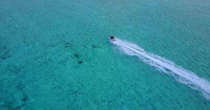 V06185 Aerial flying drone view of Maldives white sandy beach jetski riding sunny tropical paradise island with aqua stock video footage