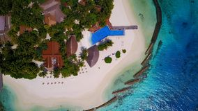 Aerial flying drone view of Maldives white sandy beach luxury 5 star resort hotel water bungalows relaxing stock photos