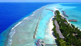 Aerial flying drone view of Maldives white sandy beach luxury 5 star resort hotel water bungalows relaxing Royalty Free Stock Photos