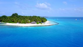 Aerial flying drone view of Maldives white sandy beach luxury 5 star resort hotel water bungalows relaxing Royalty Free Stock Photo