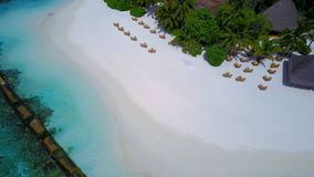 Aerial flying drone view of Maldives white sandy beach luxury 5 star resort hotel water bungalows relaxing Royalty Free Stock Image
