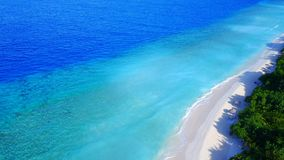 Aerial flying drone view of Maldives white sandy beach luxury 5 star resort hotel water bungalows relaxing Stock Photo