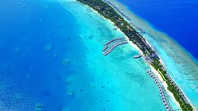 Aerial flying drone view of Maldives white sandy beach luxury 5 star resort hotel water bungalows relaxing Stock Images