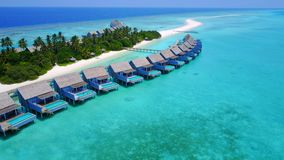 P02615 Aerial flying drone view of Maldives white sandy beach luxury 5 star resort hotel water bungalows relaxing Royalty Free Stock Photos
