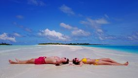 P02523 Aerial flying drone view of Maldives white sandy beach 2 people young couple man woman romantic love on sunny Stock Photo