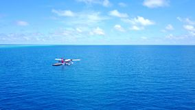 P02645 Aerial flying drone view of Maldives white sandy beach seaplane on sunny tropical paradise island with aqua blue Royalty Free Stock Image