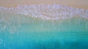 P02197 Aerial flying drone view of Maldives white sandy beach on sunny tropical paradise island with aqua blue sea water Stock Images