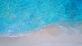 P02196 Aerial flying drone view of Maldives white sandy beach on sunny tropical paradise island with aqua blue sea water Stock Image