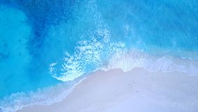 P02194 Aerial flying drone view of Maldives white sandy beach on sunny tropical paradise island with aqua blue sea water Stock Photo