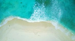 P02212 Aerial flying drone view of Maldives white sandy beach on sunny tropical paradise island with aqua blue sea water Royalty Free Stock Photo