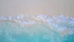 P02198 Aerial flying drone view of Maldives white sandy beach on sunny tropical paradise island with aqua blue sea water. Aerial flying drone view of Maldives royalty free stock photo