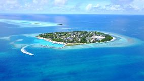 Aerial flying drone view of Maldives white sandy beach on sunny tropical paradise island with aqua blue sky sea Royalty Free Stock Images