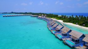 P01239 Aerial flying drone view of Maldives white sandy beach on sunny tropical paradise island with aqua blue sky sea Stock Photos