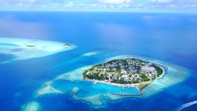 Aerial flying drone view of Maldives white sandy beach on sunny tropical paradise island with aqua blue sky sea Royalty Free Stock Image