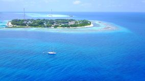 Aerial flying drone view of Maldives white sandy beach on sunny tropical paradise island with aqua blue sky sea Stock Photos