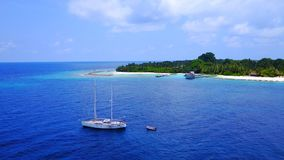 P01006 Aerial flying drone view of Maldives white sandy beach on sunny tropical paradise island with aqua blue sky sea. Aerial flying drone view of Maldives Royalty Free Stock Photo