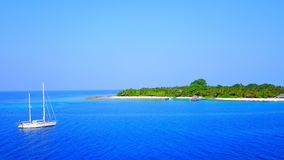 P01009 Aerial flying drone view of Maldives white sandy beach on sunny tropical paradise island with aqua blue sky sea Stock Photography