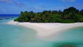 P02261 Aerial flying drone view of Maldives white sandy beach on sunny tropical paradise island with aqua blue sky sea Stock Photography