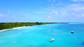 P02414 Aerial flying drone view of Maldives white sandy beach on sunny tropical paradise island with aqua blue sky sea Stock Images