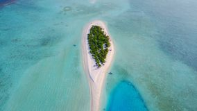 P02447 Aerial flying drone view of Maldives white sandy beach on sunny tropical paradise island with aqua blue sky sea Stock Photos