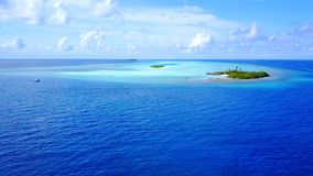 P02253 Aerial flying drone view of Maldives white sandy beach on sunny tropical paradise island with aqua blue sky sea Stock Photography